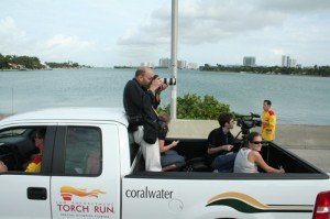Me riding in the back of pick-up while taping the Special Olympics torch run on Jan. 13. We were driving on the McArthur Causeway over Biscayne Bay. Photo by Andrea Ballocchi